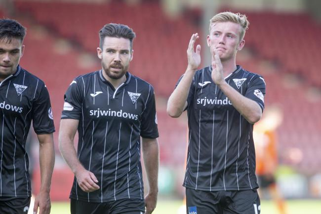 Kyle Turner (right) applauds the fans after Saturday's loss to Dundee United. Photo: Craig Brown.