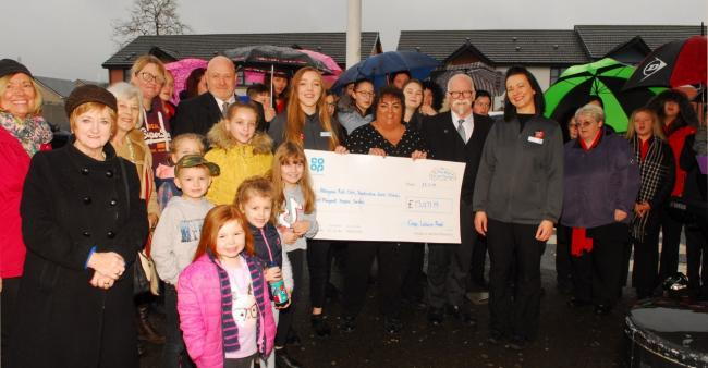 Staff and customers from the Co-op stores handed over cash to three local charities on Saturday. Pic: Ted Milton