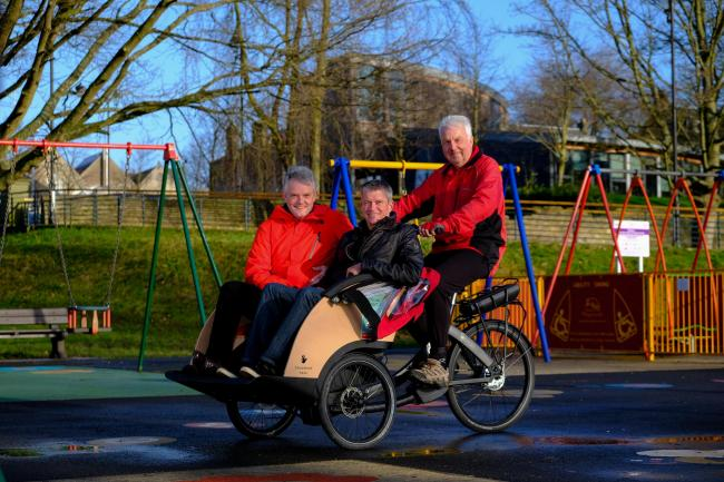 Carnegie Dunfermline Trust chairman Ian Wilson, trustee Mike Reid and Cycling Without Age volunteer Malcolm Corbett. Photo: Jim Payne.