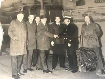 Superintendent William Moodie standing between the-then Chief Constable Robert Murison and a representative from the Navy.