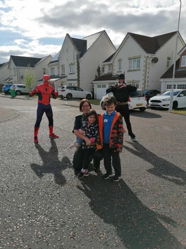 Sharron with her two kids and some of the Dunfermline superheroes!
