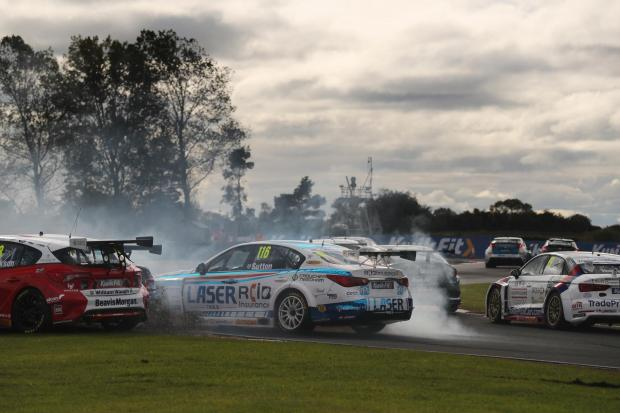 Rory Butcher and Ash Sutton come together at Snetterton on Sunday. Photo: Jakob Ebrey / BTCC.