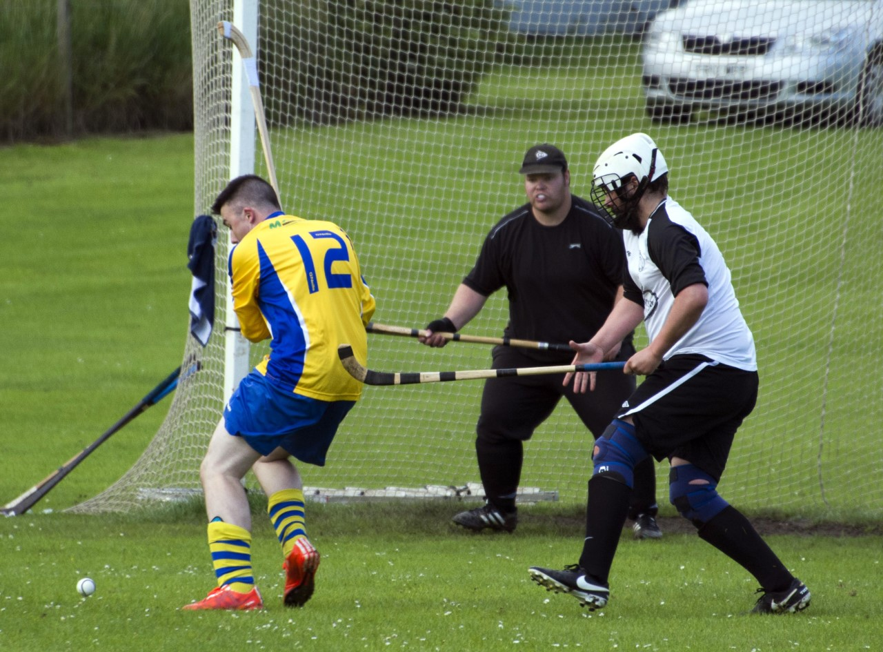 Aberdour's Sam Evans challenges for the ball as Tayforth home in on Craig Callaghan's goal. Photo: John Fullerton.