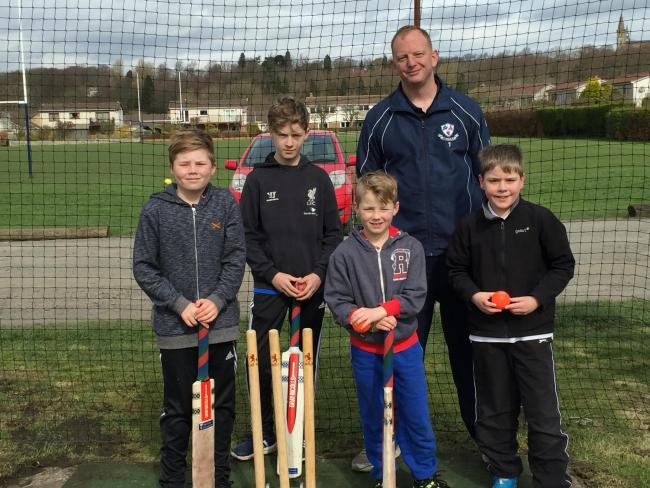 Dunfermline and Carnegie president Richie Barclay and some of the club's aspiring young cricketers.