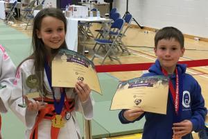 Jocelyn and Isaac Callaghan show off their prizes.