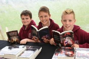 Primary 7 pupils Joe Higgins, Danny Daley and Callum Kitson checking out some of the books on offer at the literacy festival