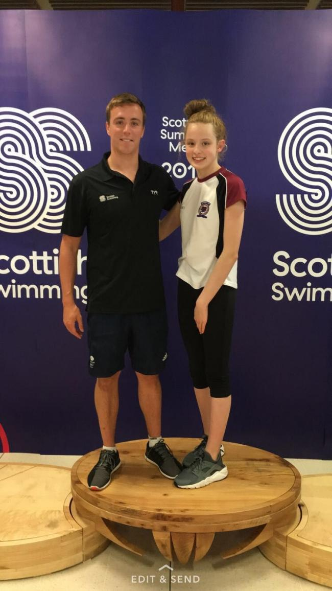 Emma with 2010 Commonwealth Games champion and Rio 2016 Olympic silver medallist Robbie Renwick at the Scottish Summer Meet. Photo: Stuart Russell