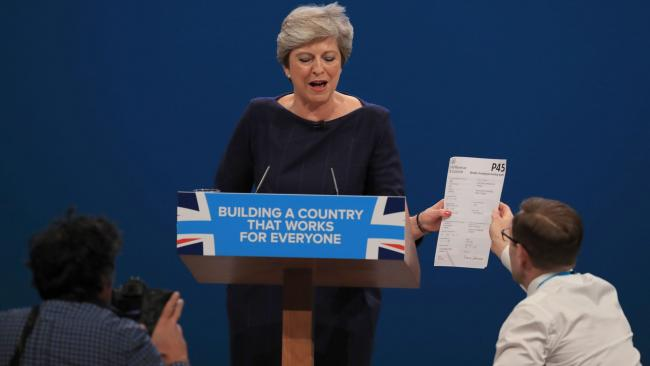 Comedian Simon Brodkin, also known as Lee Nelson confronts Prime Minister Theresa May during her keynote speech at the Conservative Party Conference
