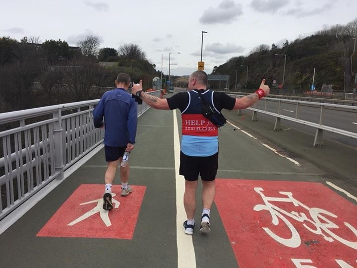 Steven Turbull crossed the Forth Road Bridge 62 times to run 100 miles in 24 hours.