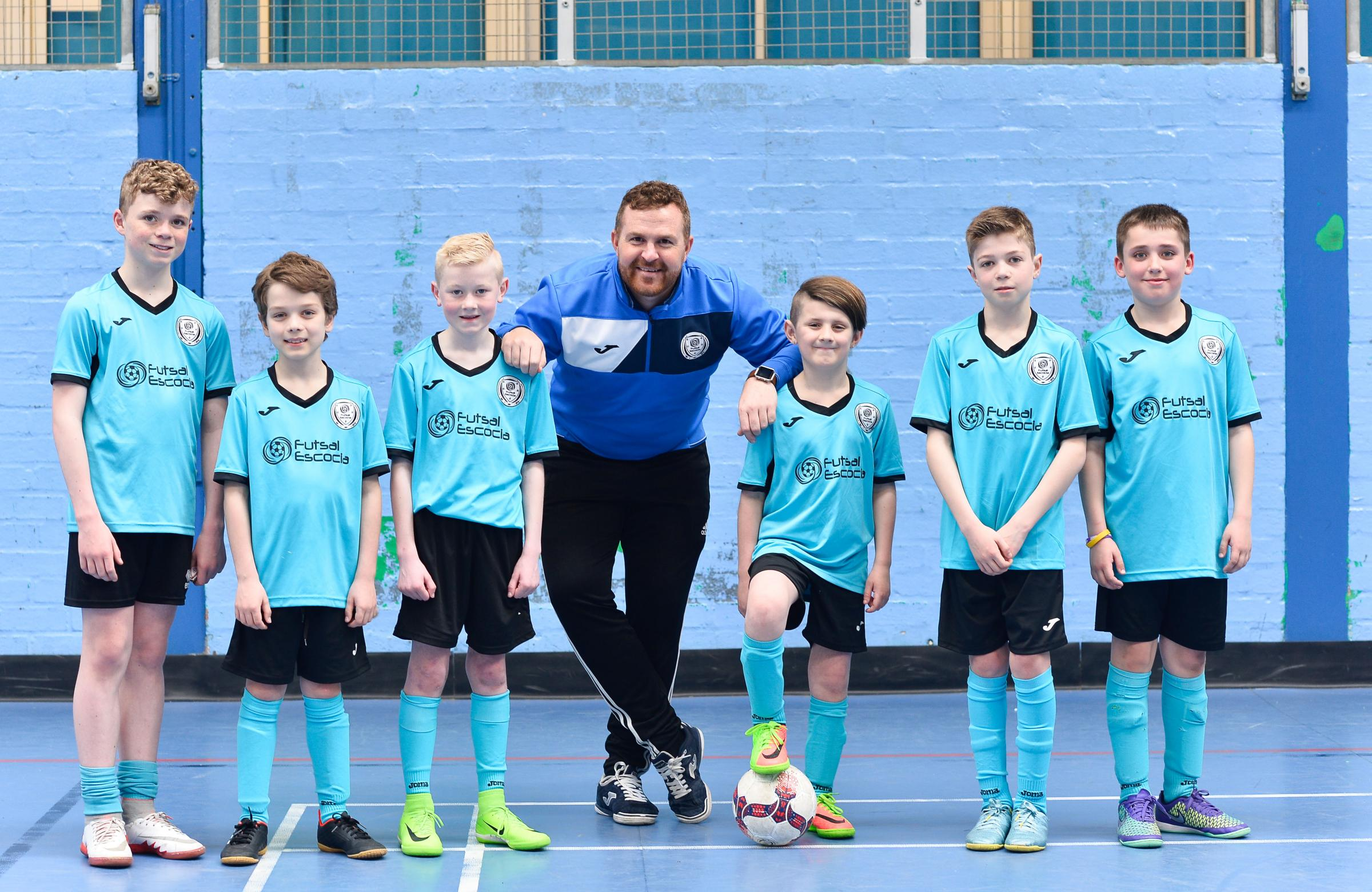 Former Dunfermline Athletic player Russell Taylor coaches children at Inverkeithing High School. Photo: Julie Howden