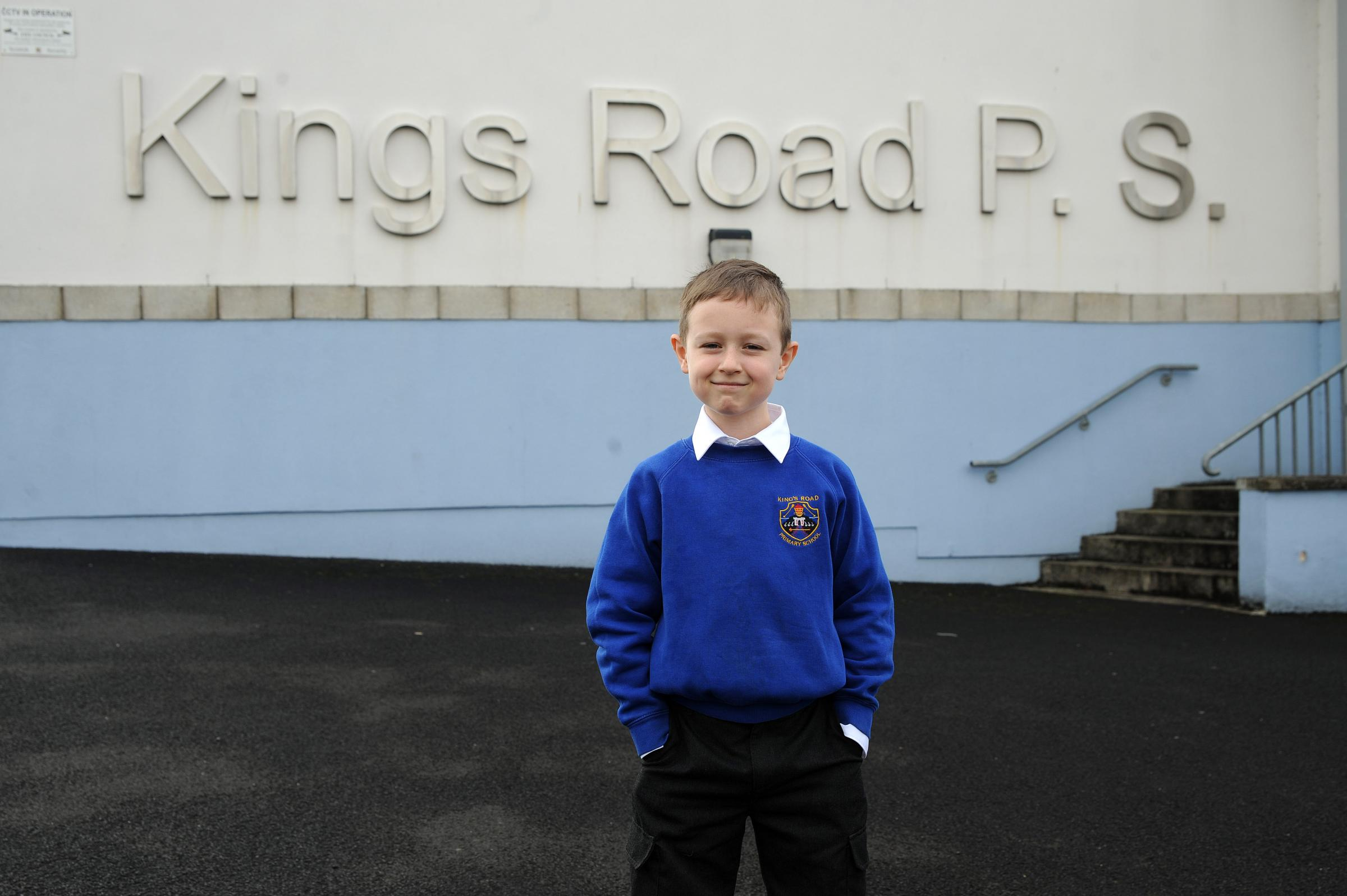 Wee Michael's delight at going back to school