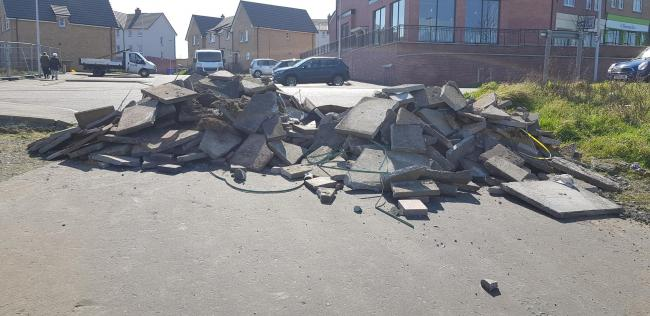 Scrap building materials dumped on Unwin Avenue in Rosyth.